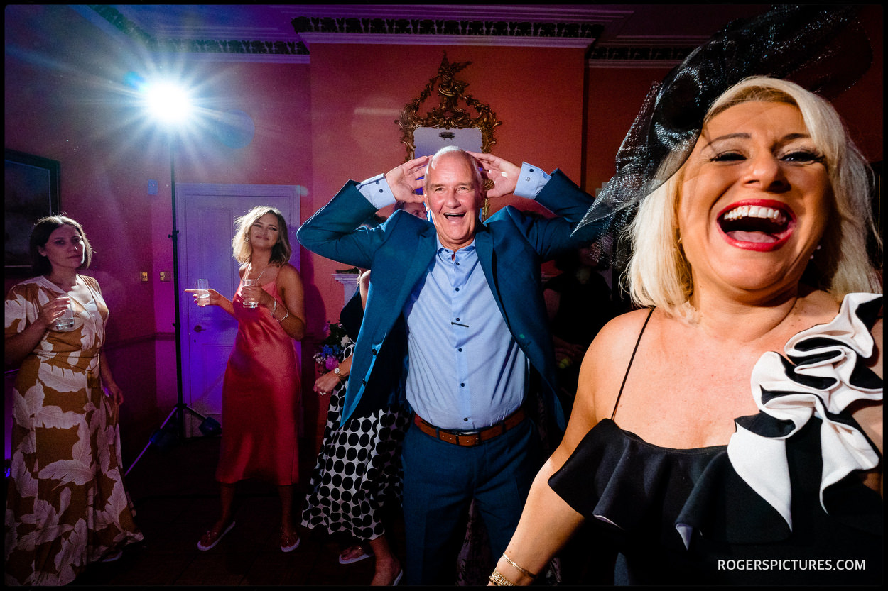 Wedding guests dancing at at Wadhurst Castle wedding party