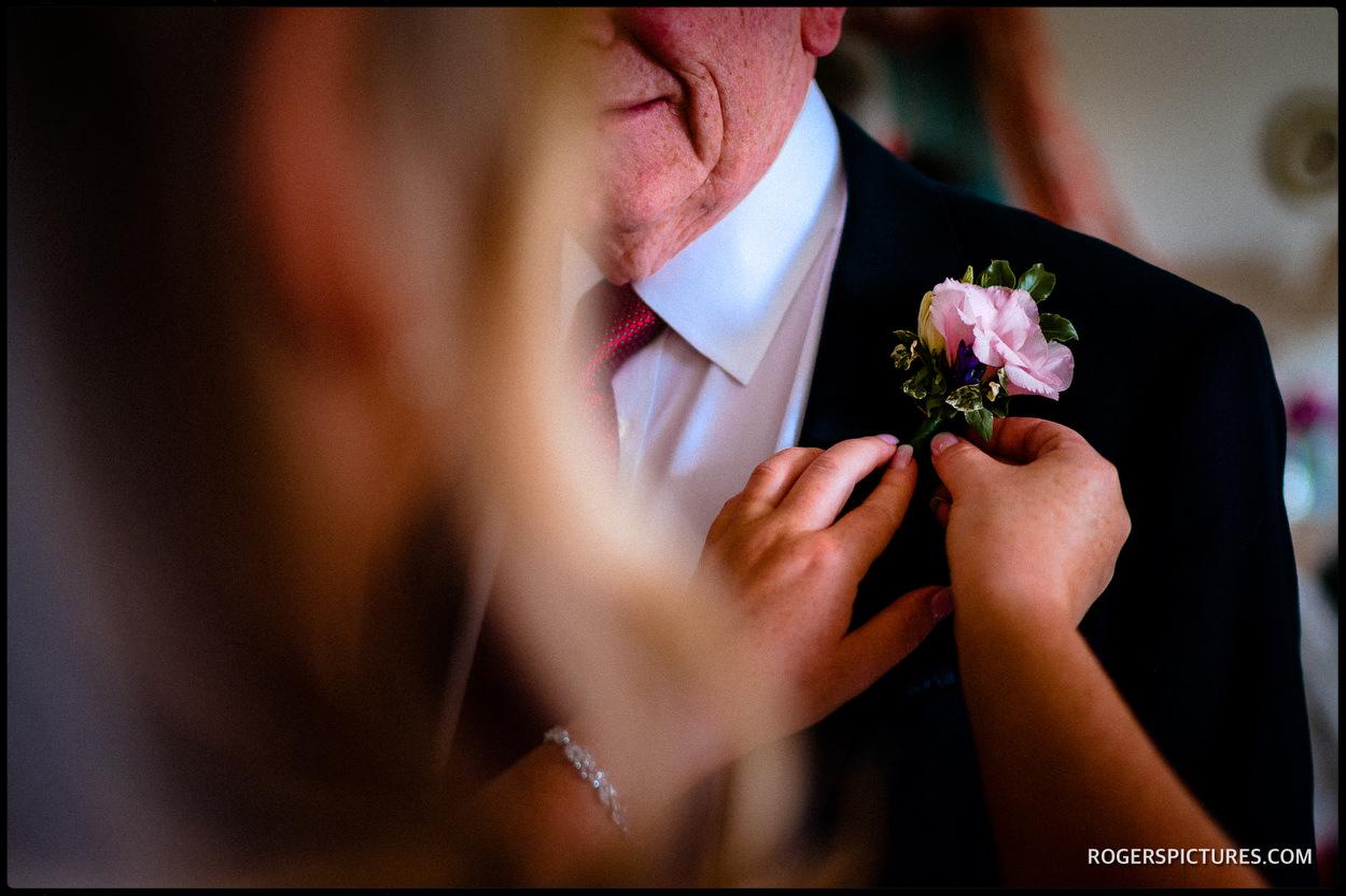 Attaching a wedding button hole