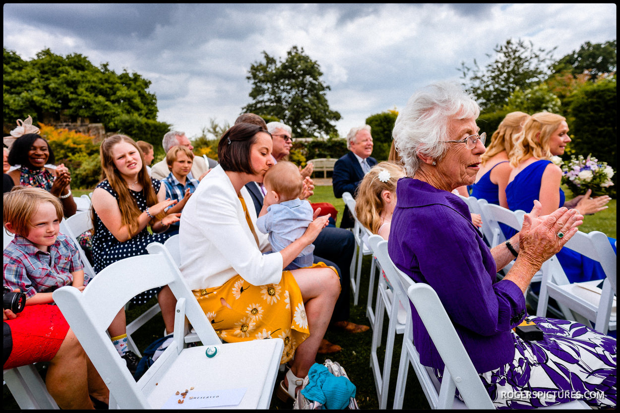 Guests at an outdoor ceremony at Wadhurst Castle in Sussex