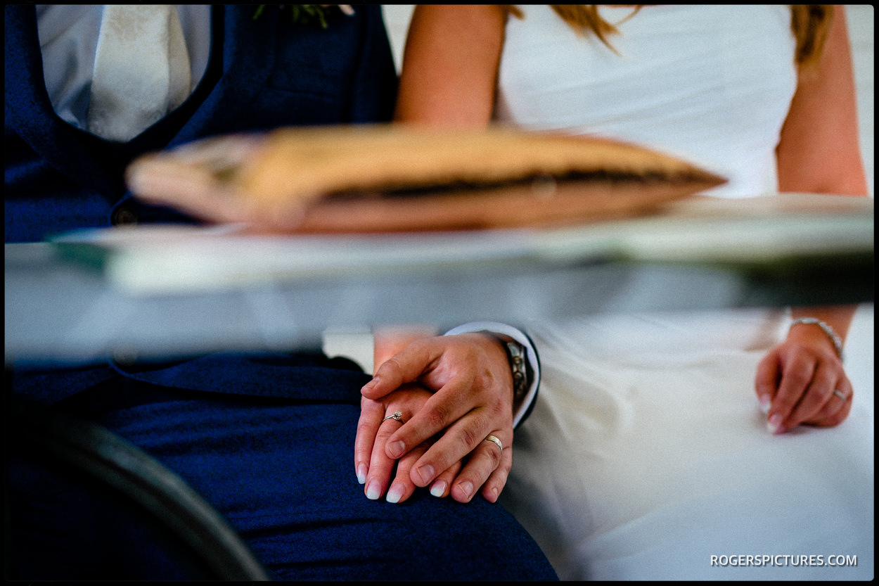 Bride and groom holding hands after outdoor wedding ceremony at Wadhurst Castle