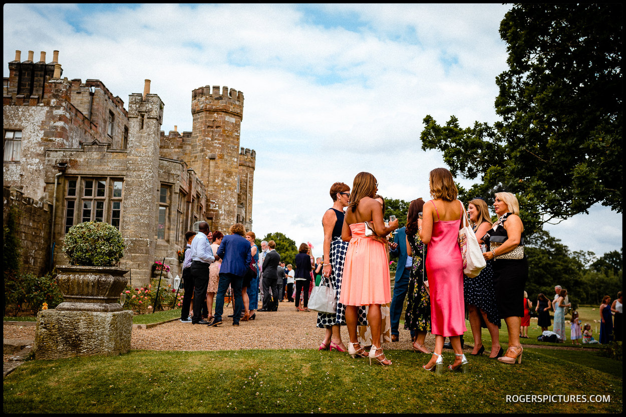 Wedding guests in castle grounds