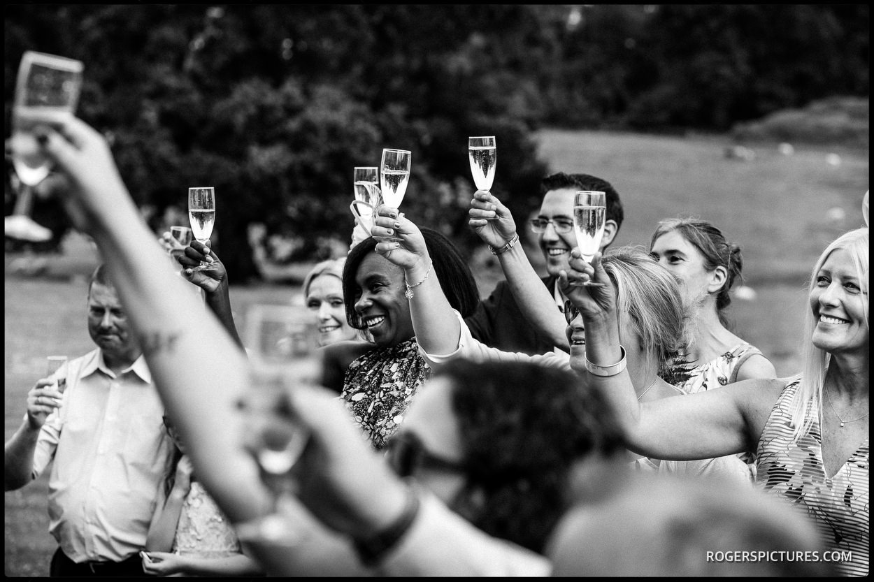 Toasts to newly weds at Wadhurst Castle