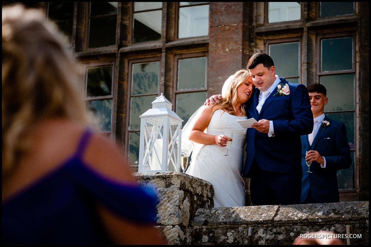 Groom ad bride during wedding speeches