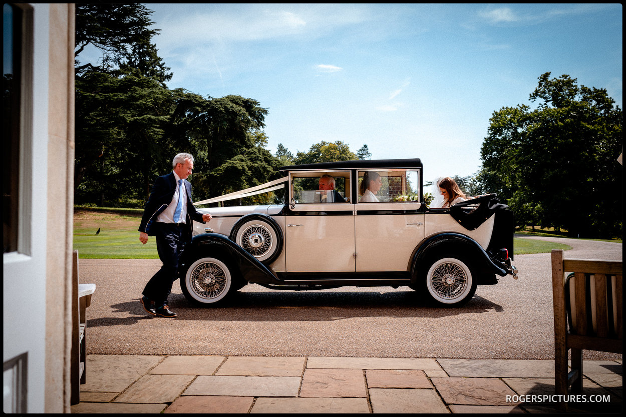 Vintage wedding car at Brocket Hall