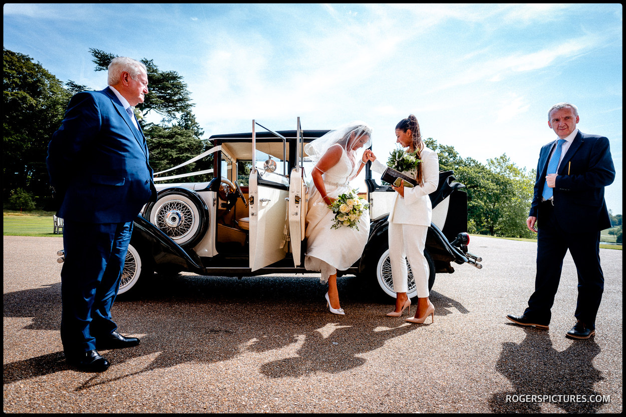Bride steps out of wedding car at Brocket Hall near Welwyn in Herts