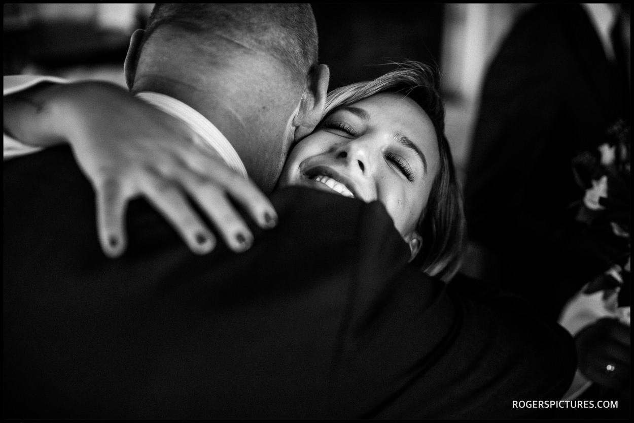 Guests embrace at a wedding