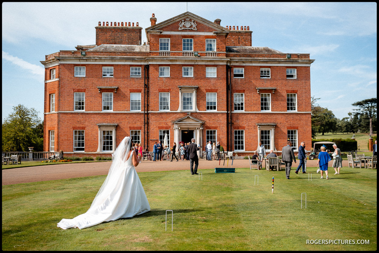 Brocket Hall wedding with bride on the lawn