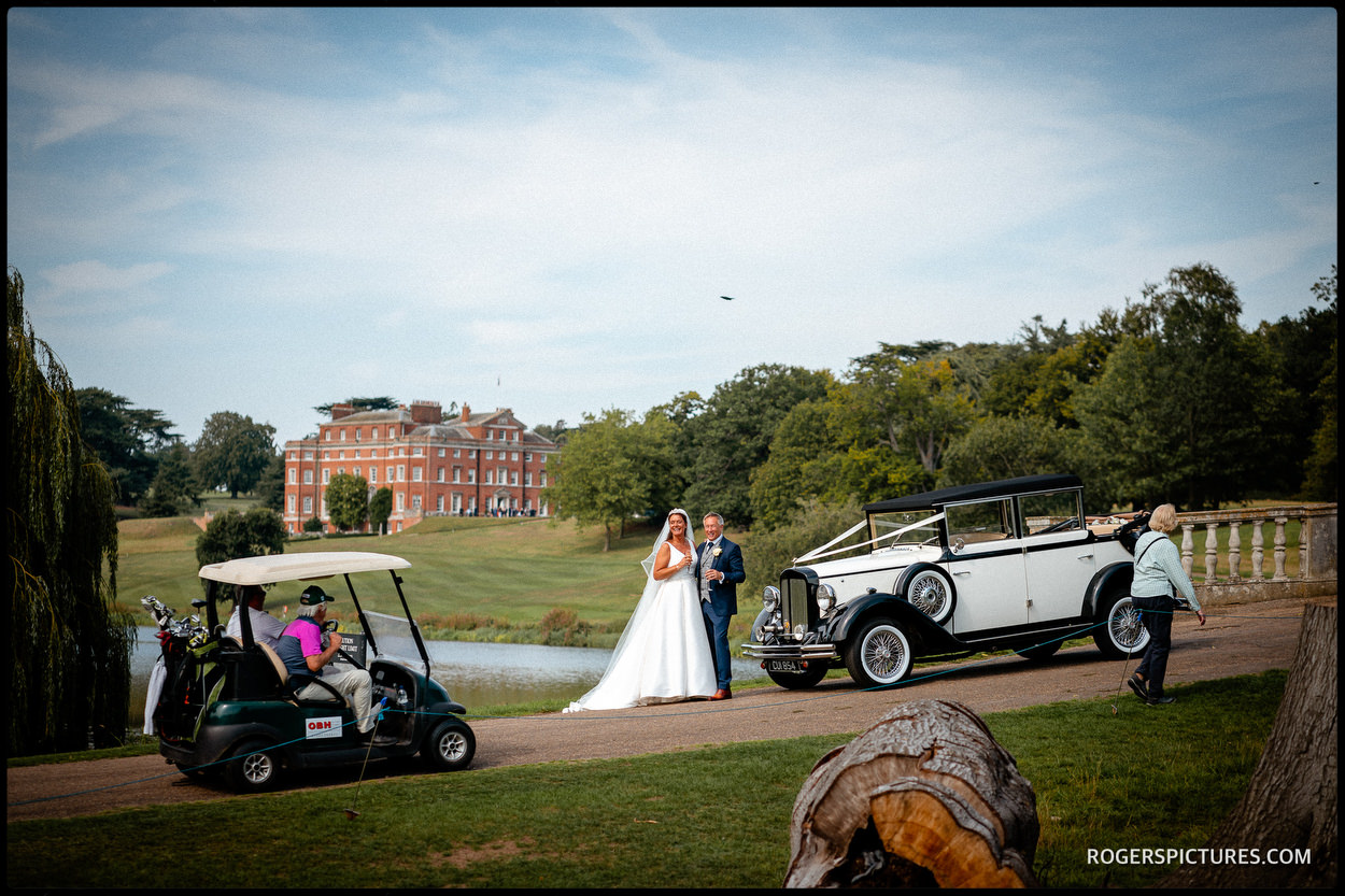 Brocket Hall newly married couple on the golf course