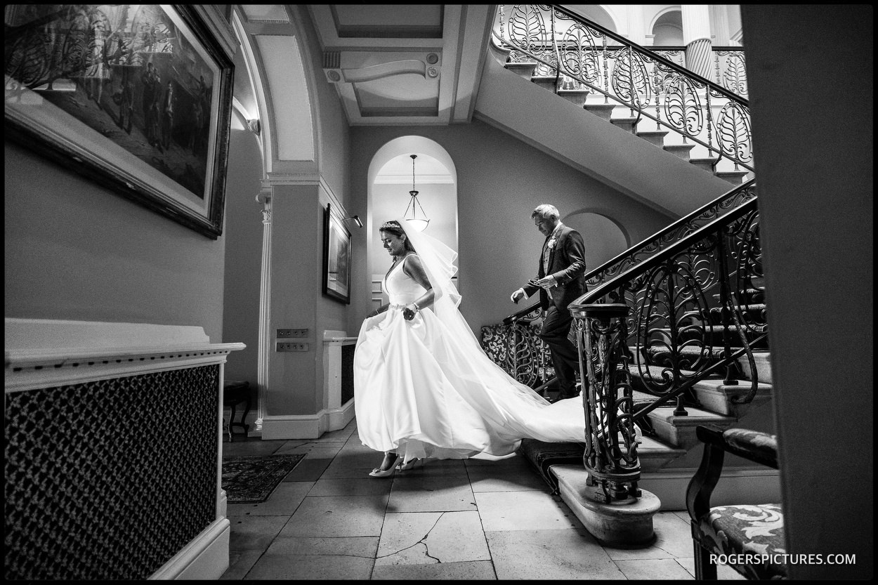 Bride on the stairs at Brocket Hall