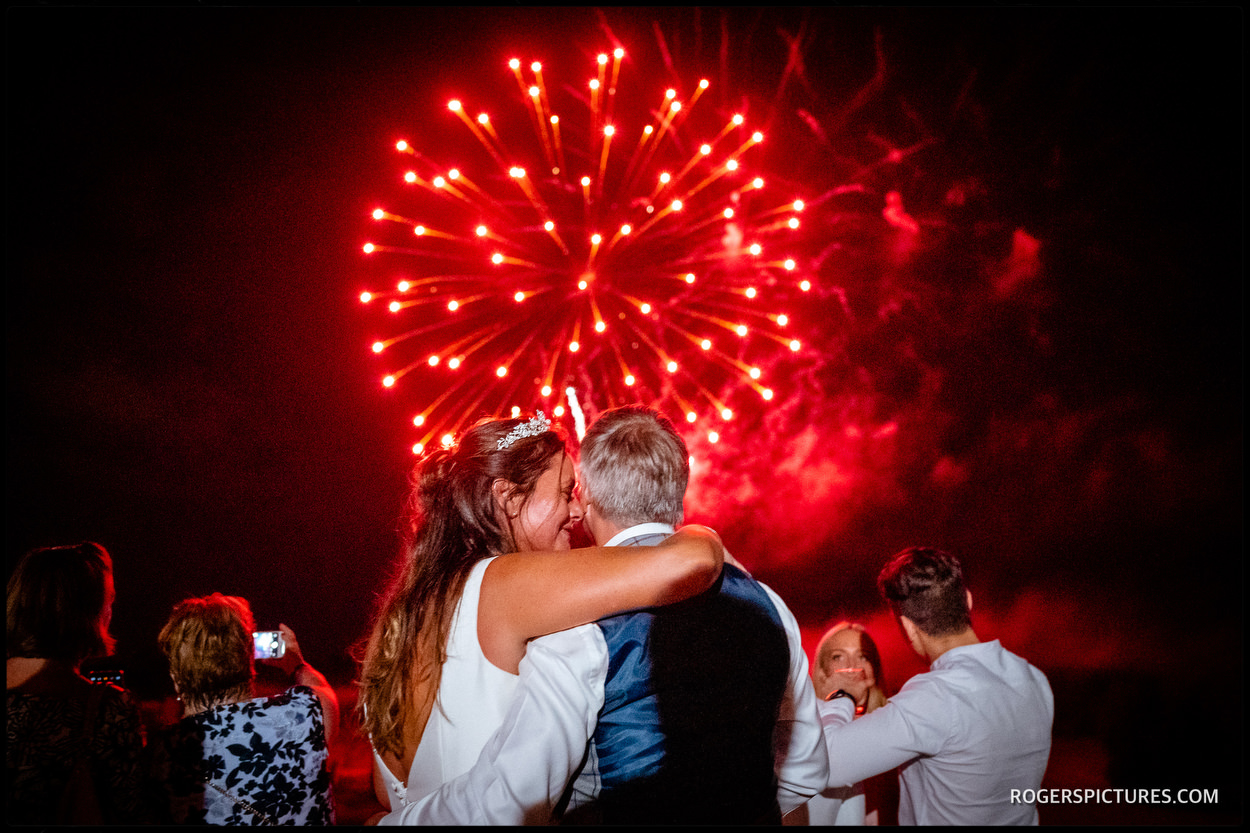 Brocket Hall bride and groom with fireworks