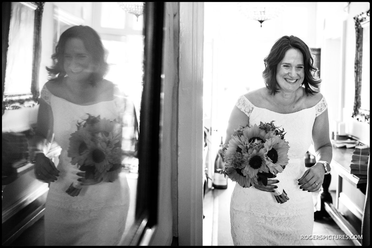Black and white photo bride arriving for Hertfordshire barn wedding