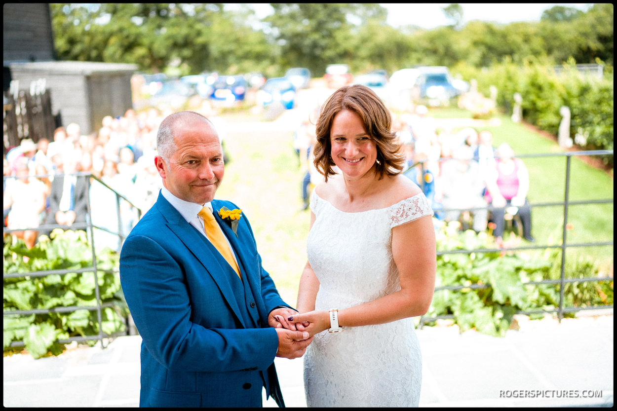 Outdoor wedding ceremony at Redcoats Farmhouse
