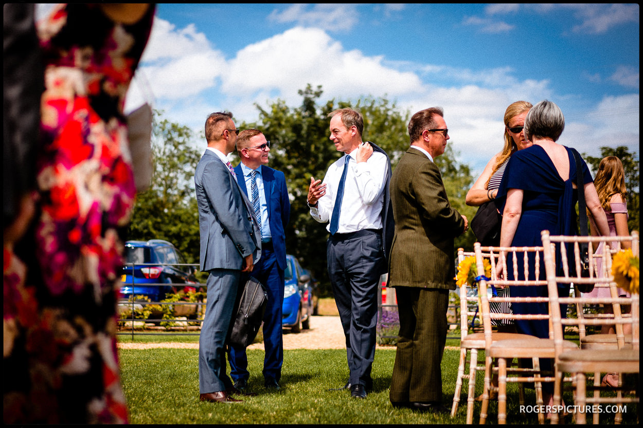 Guests enjoy sun at a Hertfordshire wedding