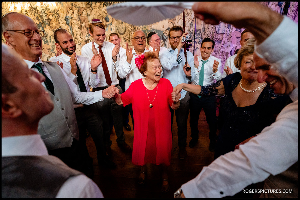 Grandma on the dance floor at a Jewish wedding