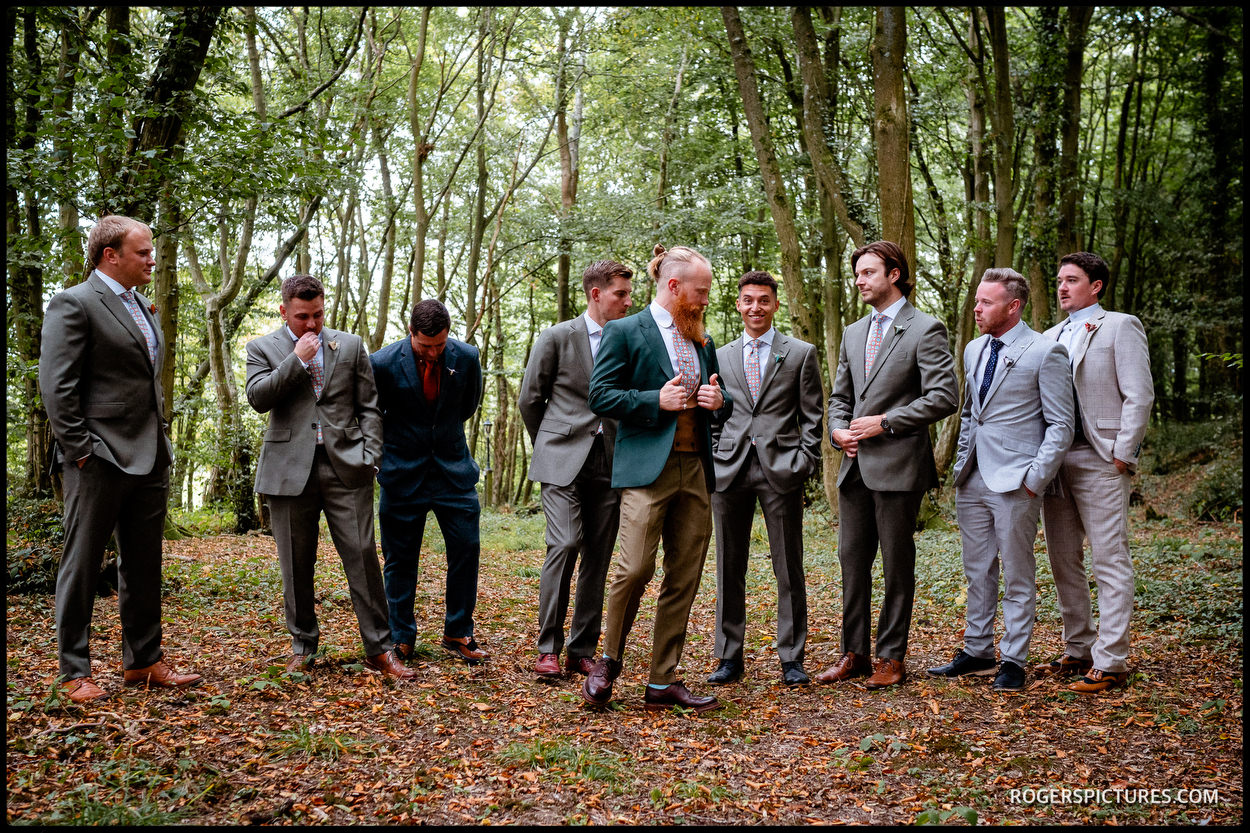 Groomsmen before an outdoor ceremony at Swallows Oast