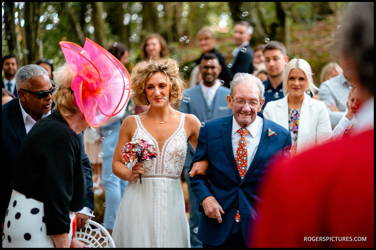 Bride arrives for wedding ceremony with her grandad