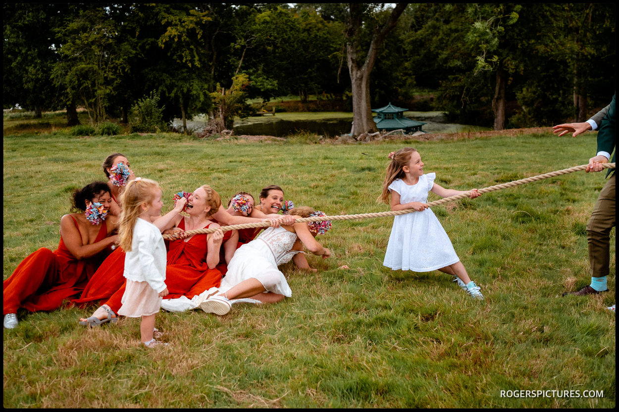 Tug of war at Swallows Oast wedding