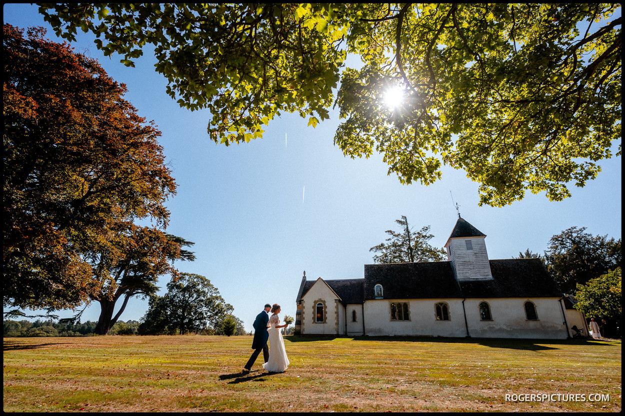 Bride walking to St Nicholas' Church at Wasing Park in Berkshire