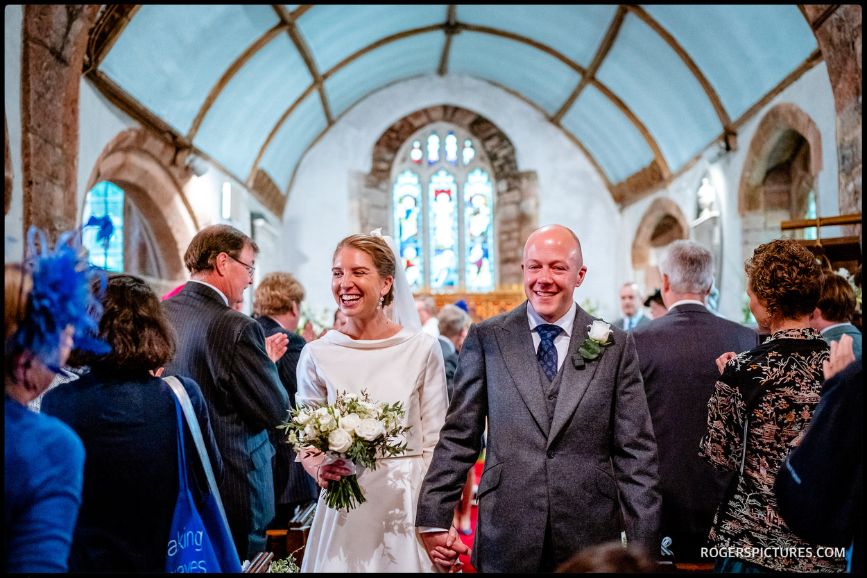 Newly married couple at Devon church wedding