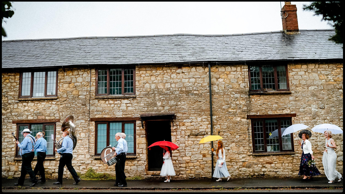 Rainy bridal party by wedding photographer Paul Rogers