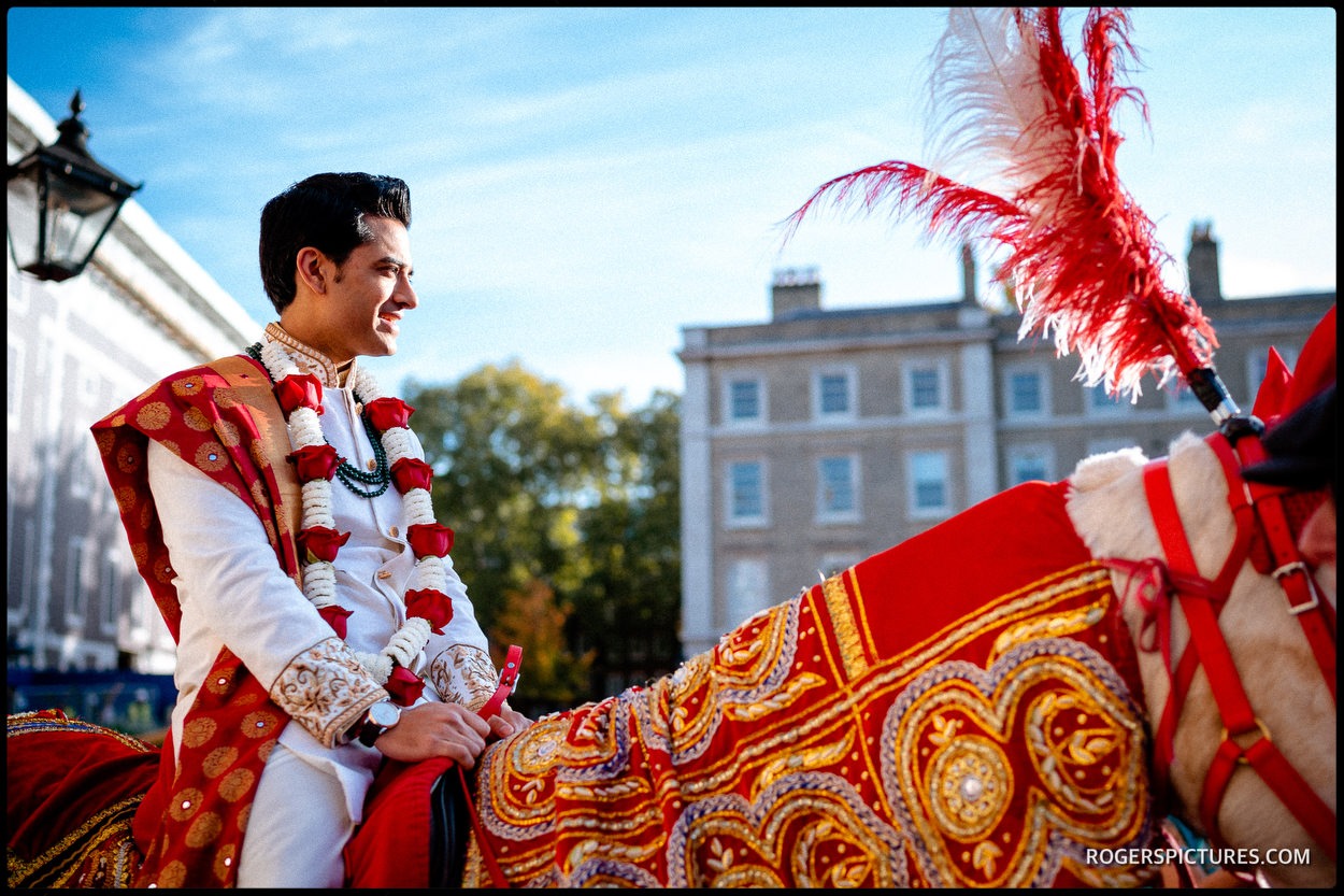 Indian groom arrives on horseback