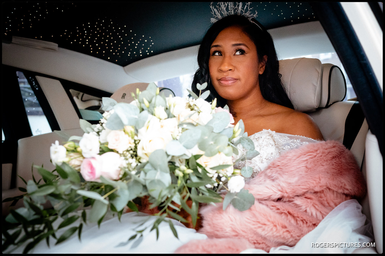 Bride arrives in Rolls Royce at Kensington Temple in London
