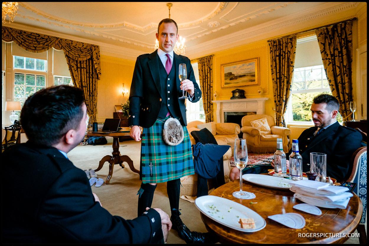 Groom in a kilt at a wedding at Glenapp Castle in Scotland