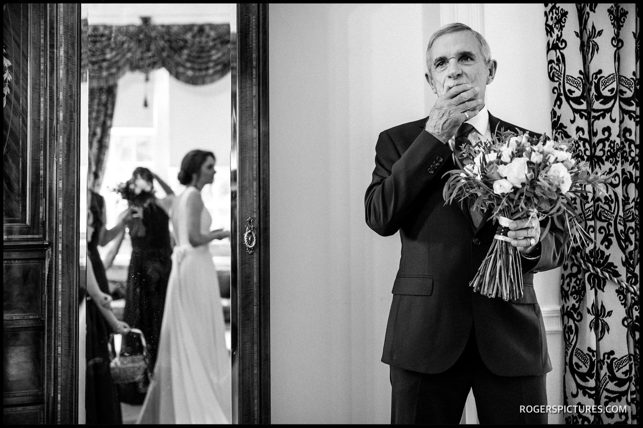 Father of the bride reacts to seeing her in a wedding dress