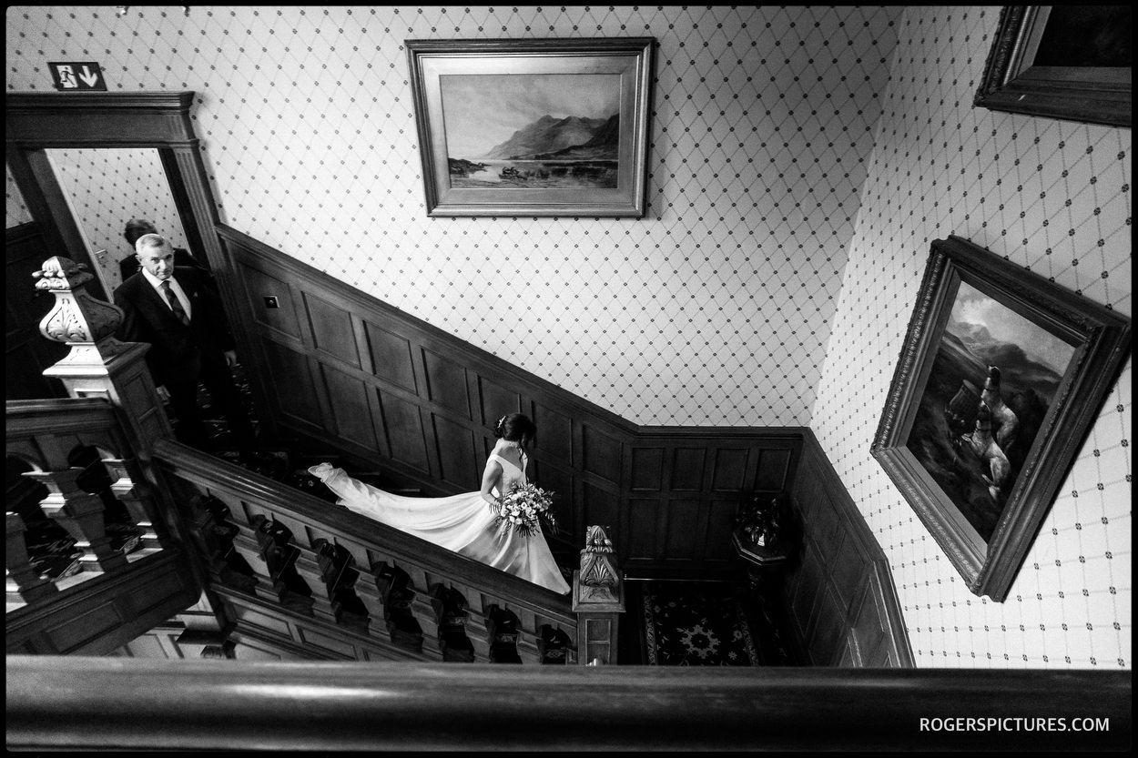 Bride in dress on stairway at Glenapp Castle in Ayrshire
