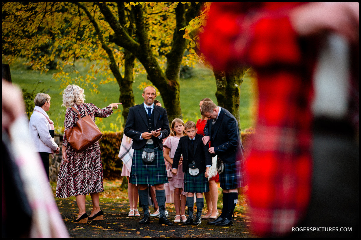 Scottish wedding guests in kilts