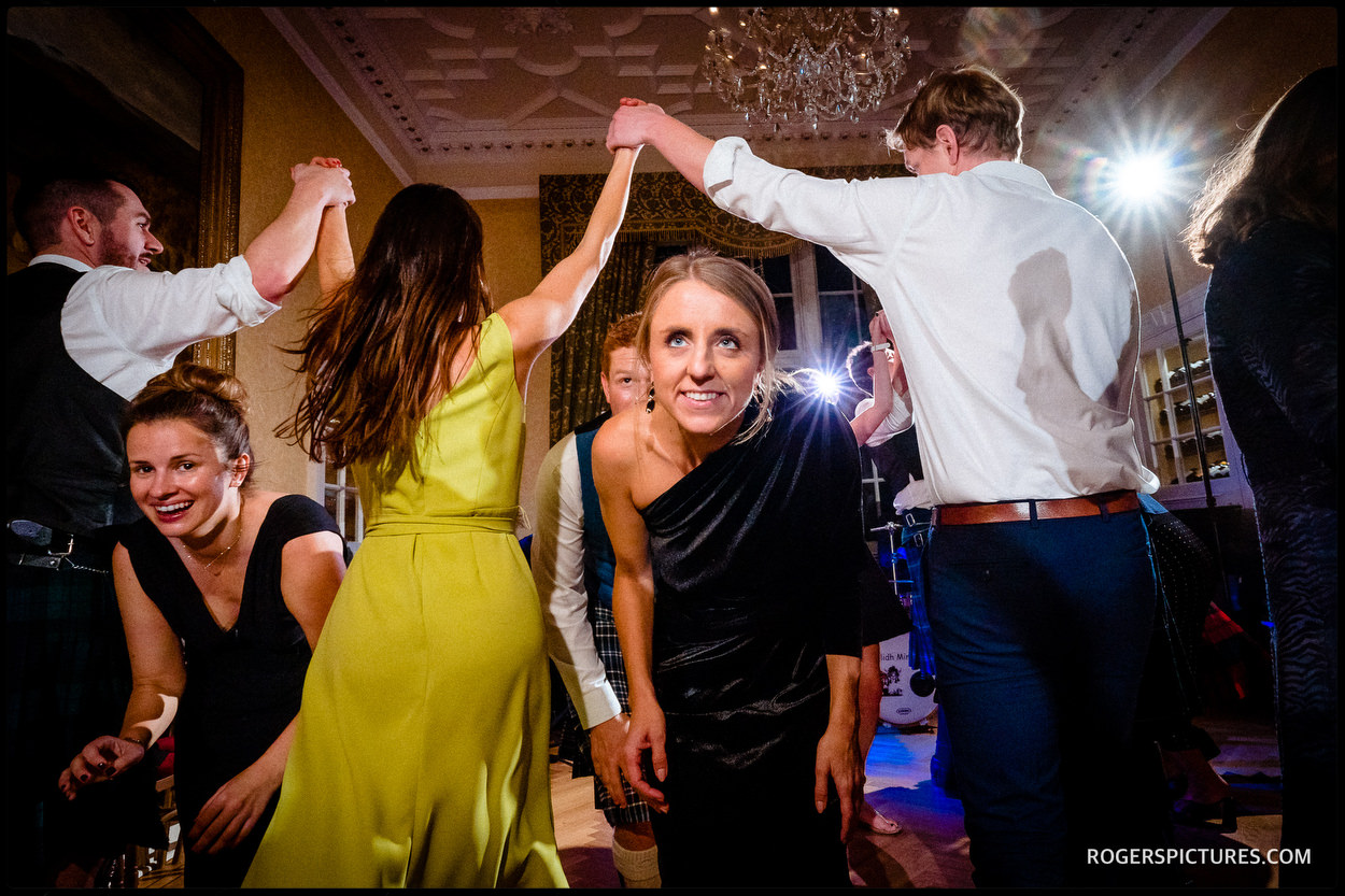 Scottish Ceilidh dance at a castle wedding