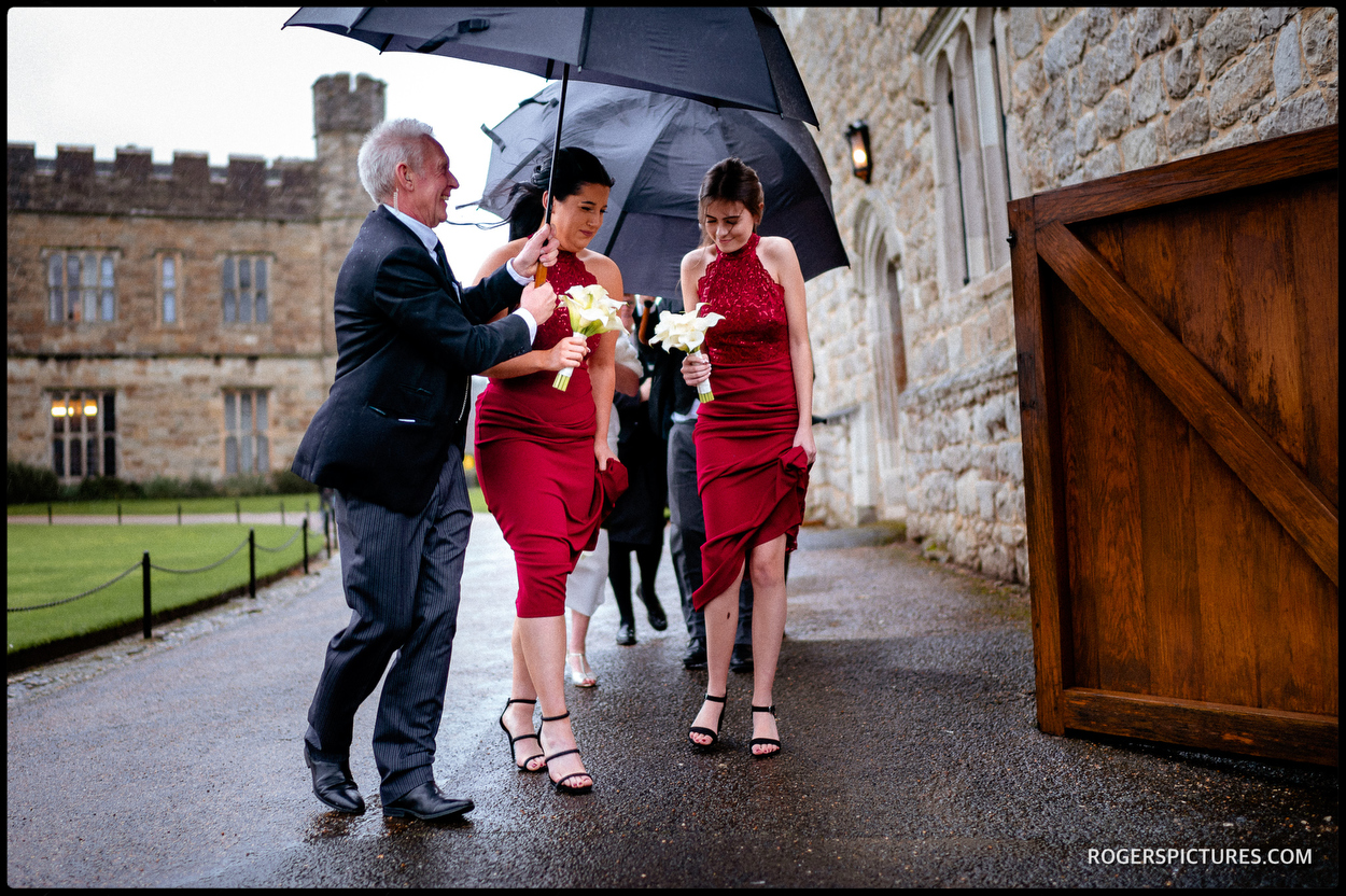 Bridesmaids in the rain at Leeds Castle