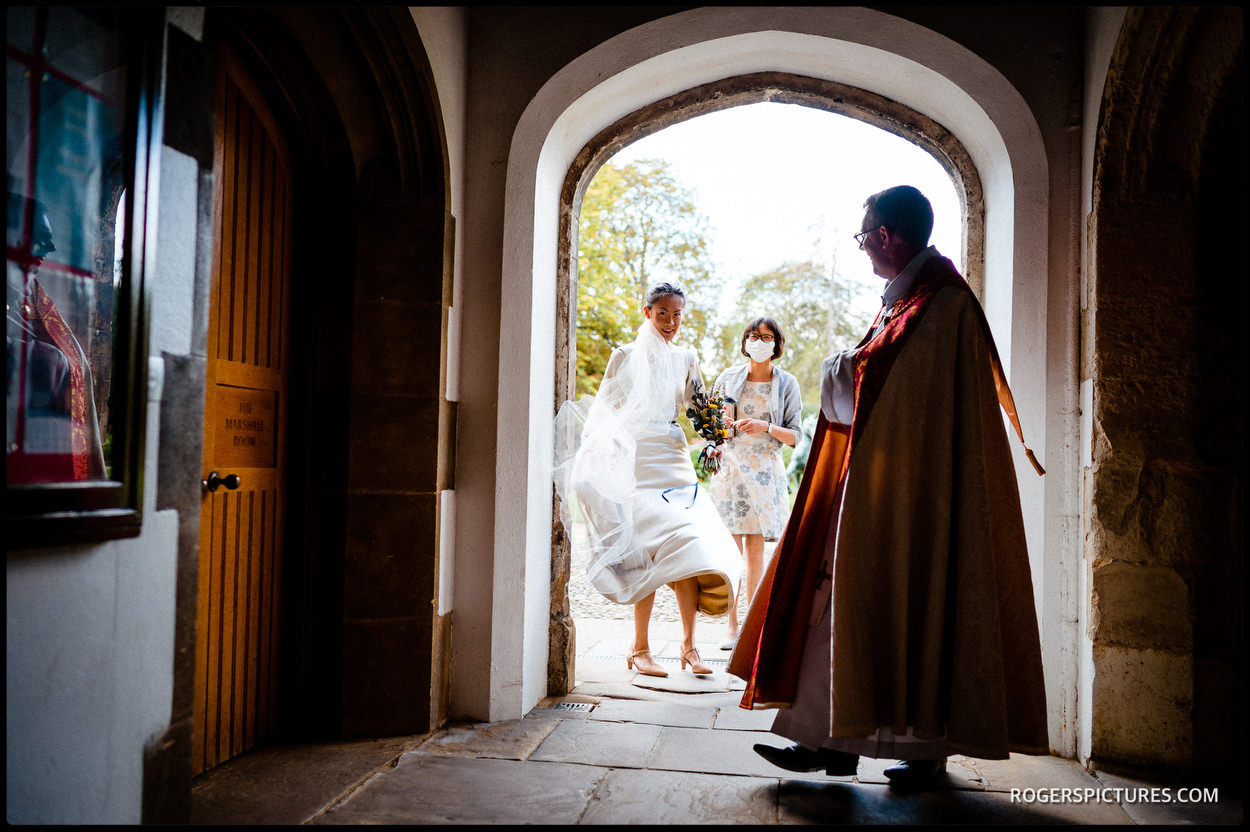 Bride arrives to marry at Jesus College chapel