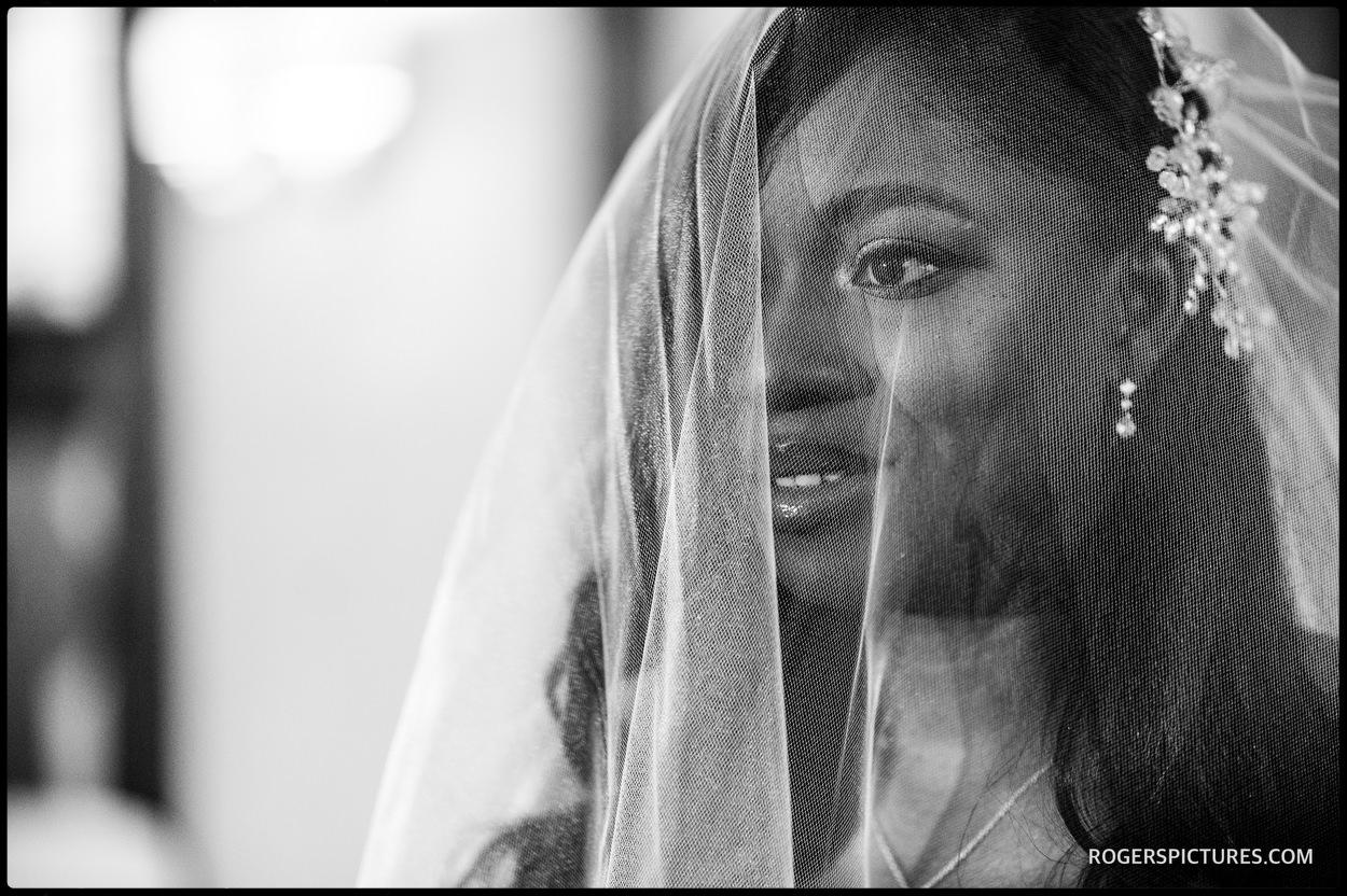 Documentary wedding photo of bride in veil