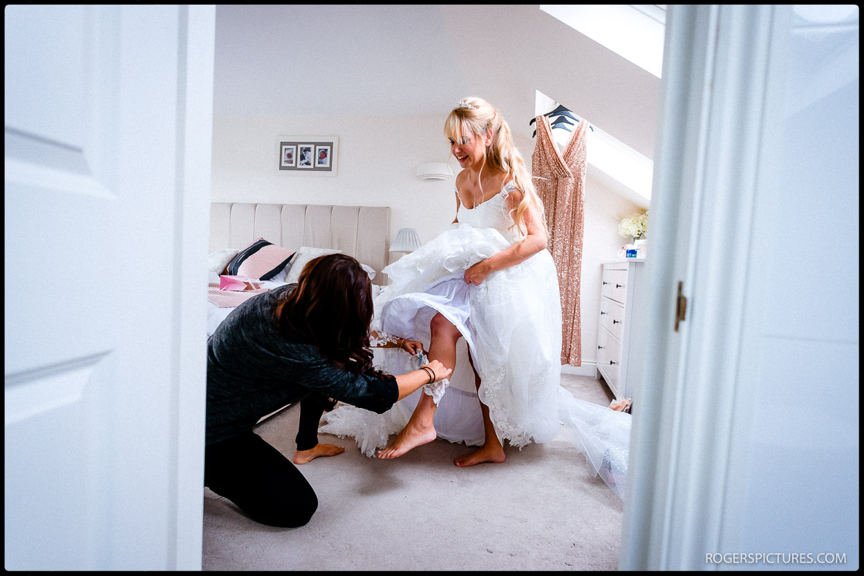Bride putting on a garter before getting married