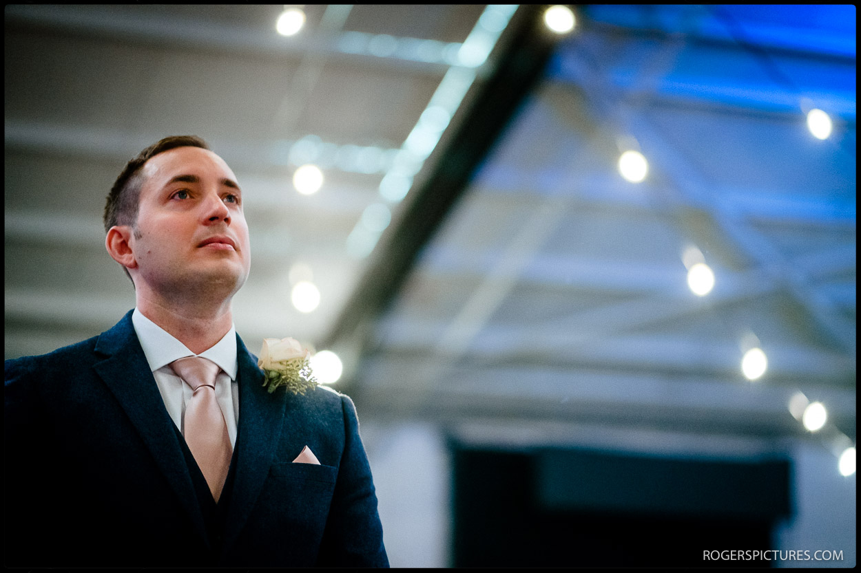 Nervous groom awaits arrival of bride
