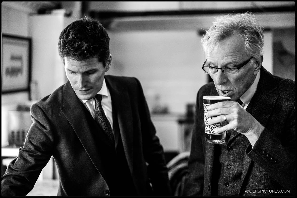 Black and white photo of groomsmen before a church wedding