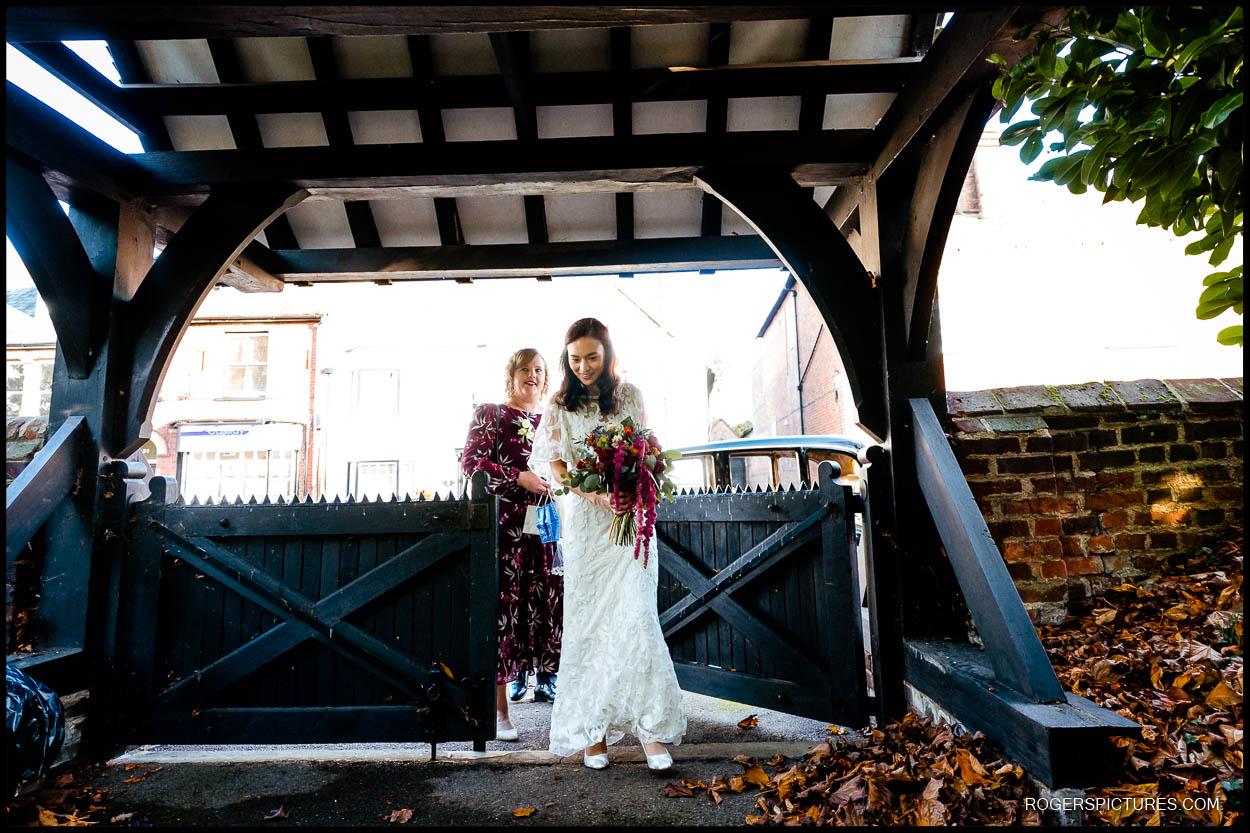 Bride at church lych gate