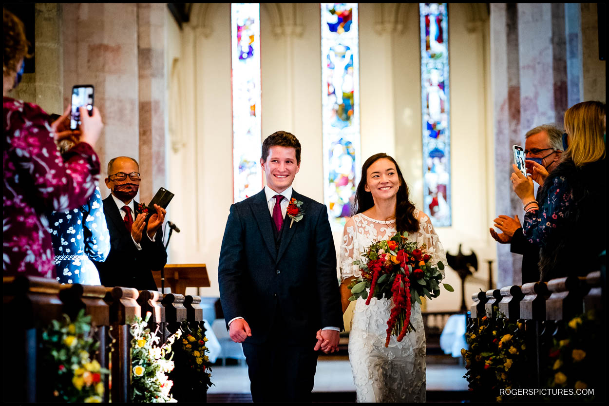 Newly wed couple in Hertfordshire church wedding