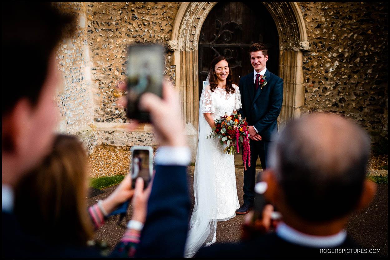 Wedding couple in church doorway