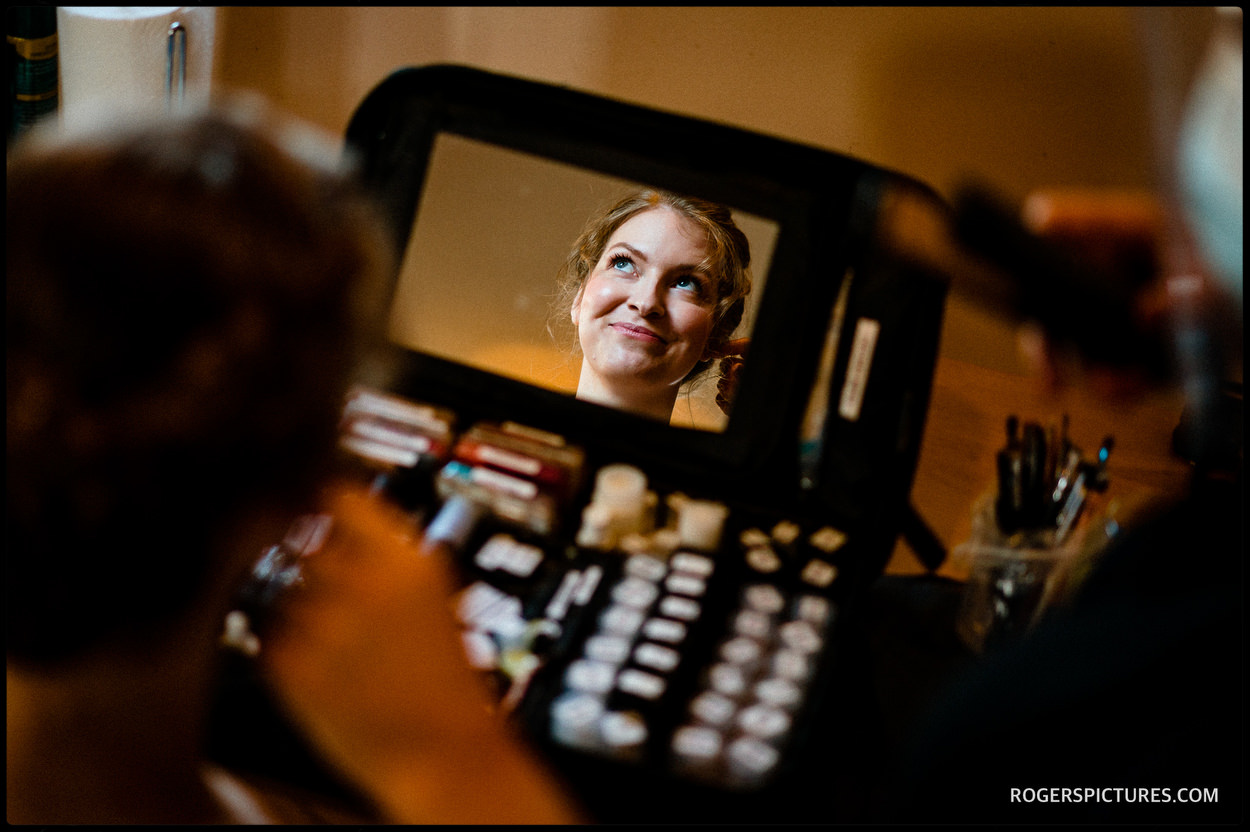 Bride reflected in make-up mirror
