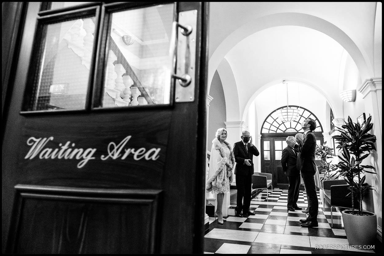 Wedding guests wait at Chelsea Town Hall