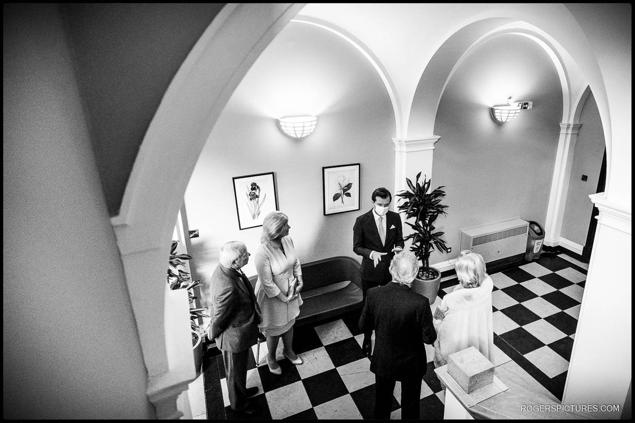 Black and white wedding guests at Chelsea Town Hall