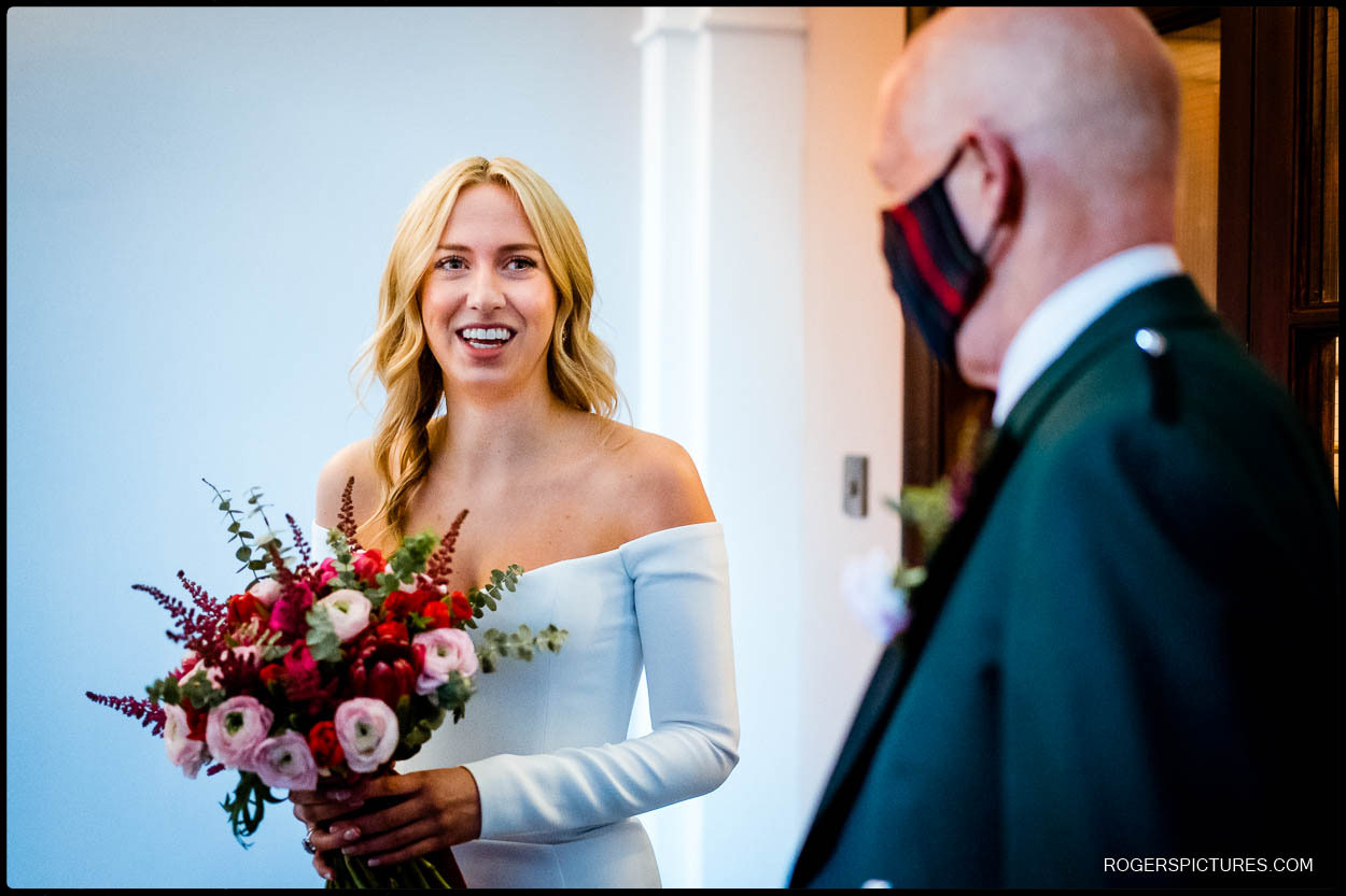 Bride with bouquet at Chelsea Town Hall wedding
