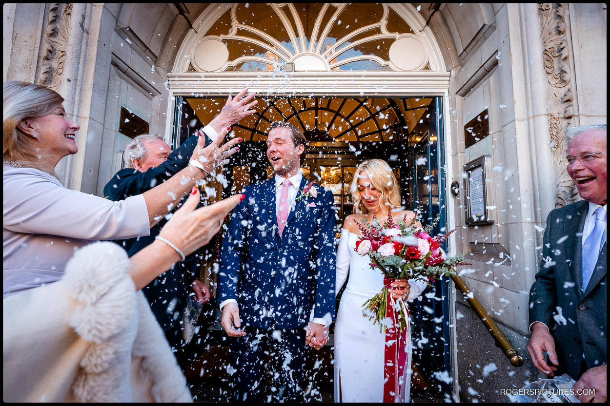 wedding couple confetti at chelsea town hall
