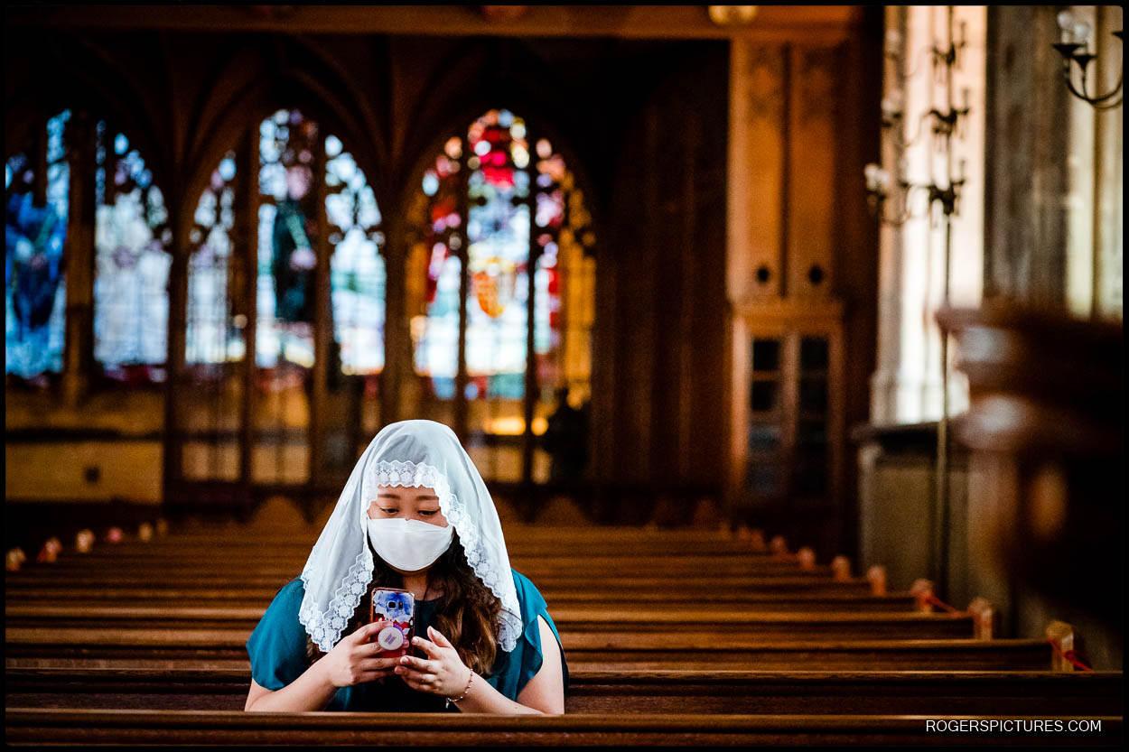 Wedding guest in St Etheldreda's church London