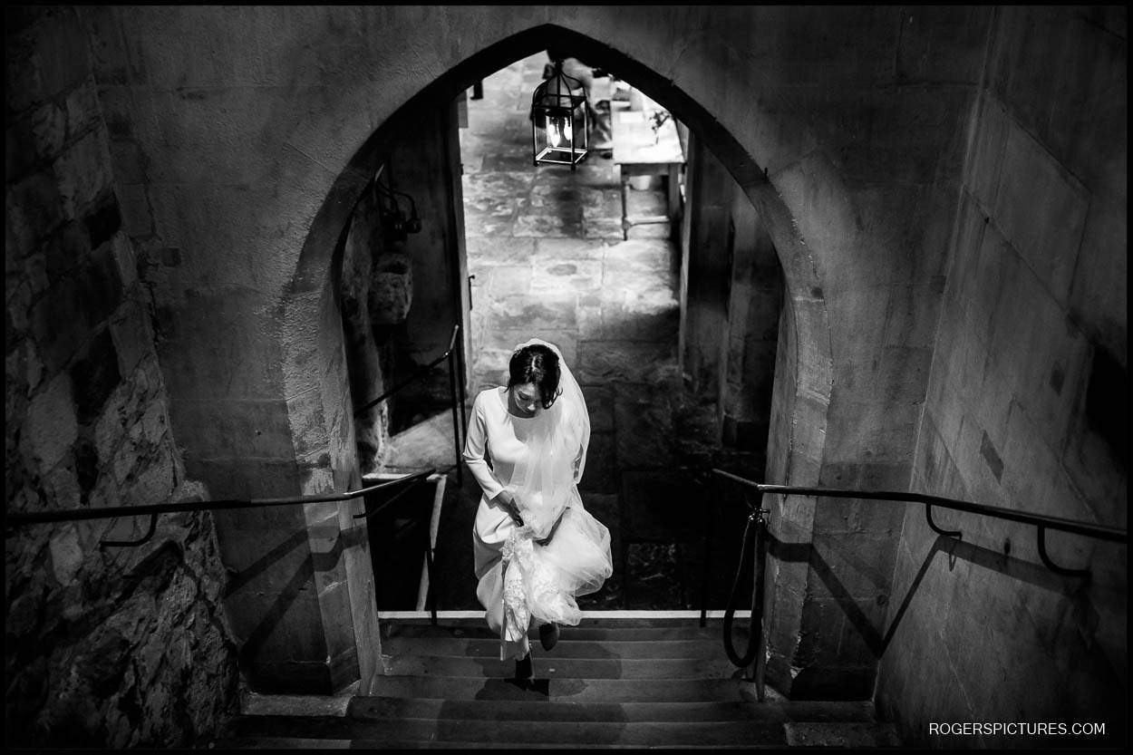 Black and white photo pf bride arriving at St Etheldreda's church London