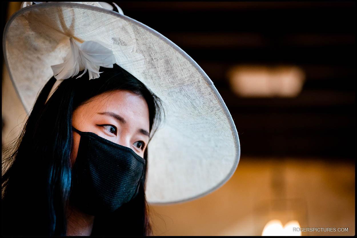 Wedding guest in hat