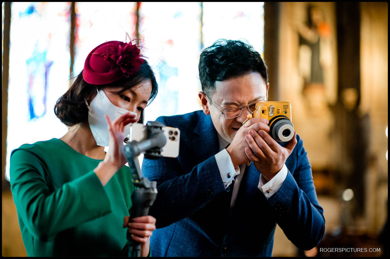 Groom with a camera