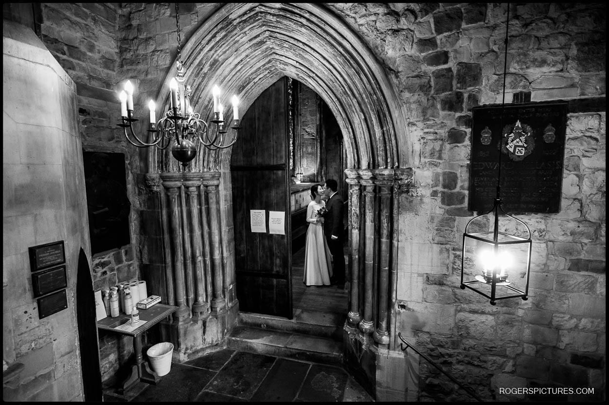 Bride framed in doorway in London church